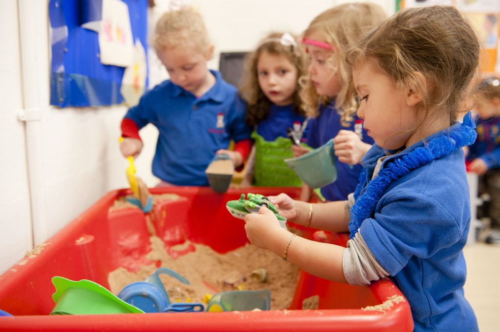 Playing with sand in in Gan Nursery & pre-school in the Bushey United Synagogue