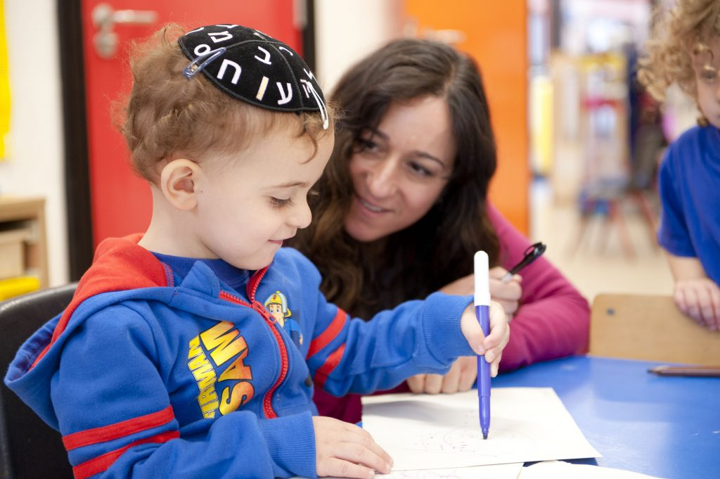 Learning to use a pen in Gan Nursery & pre-school in the Bushey United Synagogue
