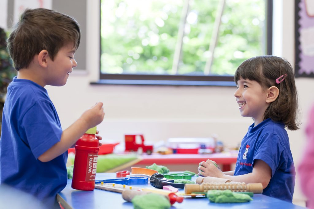 Children playing at Bushey Gan - information will be added to their learning journal